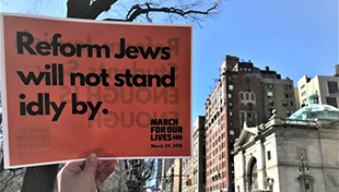 """Sign saying """"Reform Jews will not stand idly by."""""""